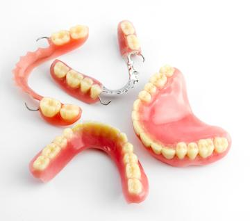 modern dentures | tooth replacement options durham nc